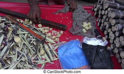 fresh sugarcane pieces in market - fresh sugarcane pieces in...