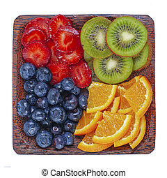 Fresh summer berries and fruits  assortment on the wooden  plate