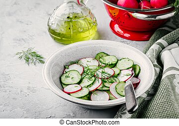 Fresh summer salad with radish and cucumber, green onions and dill