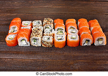 Fresh sushi roles on a wooden plate