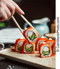 fresh sushi with red caviar