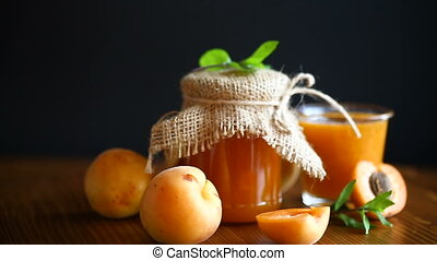 fresh sweet apricot jam on a wooden table