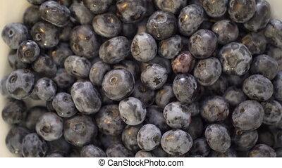 Fresh sweet blueberries turning around. Ripe blueberry fruit...