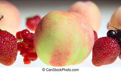 Fresh sweet fruit and berries with water drops dolly shot