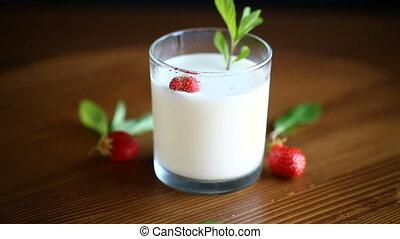 fresh sweet homemade yogurt with strawberries