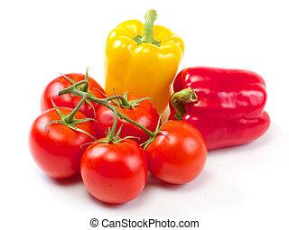 Fresh sweet pepper, tomato. On a white background.