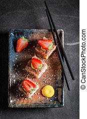 Fresh sweet sushi with cinnamon and chocolate