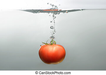 Fresh swimming fruits and vegetables - Red tempting subsea...