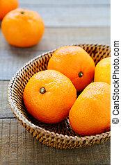 fresh tangerines in basket