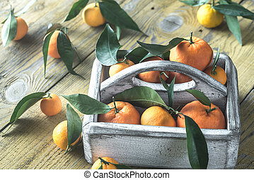 Fresh tangerines in the wooden box