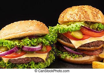 fresh tasty beef burger on dark background