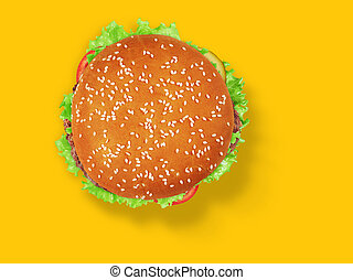fresh tasty burger on yellow background. Top view