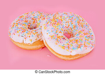 Fresh tasty colorful donuts isolated on lilac