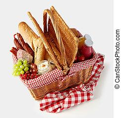 Fresh tasty food in a wicker picnic basket