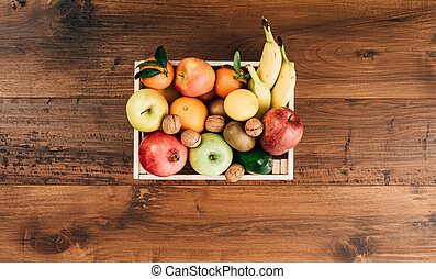 Fresh tasty fruit in a wooden crate