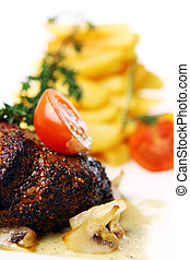 Fresh tasty meat with gourmet garnish