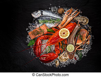 Fresh tasty seafood served on black stone.