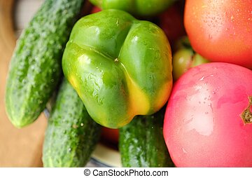 Fresh tasty vegetables on wooden background view