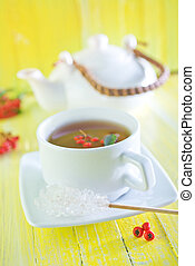 fresh tea in cup and on a table