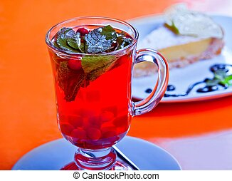Fresh tea with mint and berry