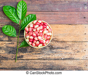 Karanda in a bowl on wooden background with Copy space