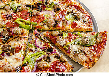 Fresh Thin Crust Supreme Pizza - Close up of sliced thin...