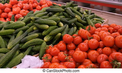 Fresh tomato and cucumbers at grocery store