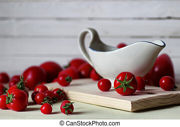 fresh tomato for ketchup on wooden background