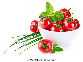 Fresh tomato in plate with green leaf