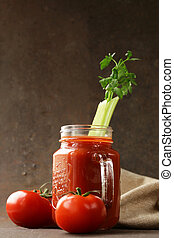 Fresh tomato juice in a glass jar