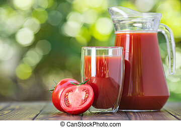 tomato juice in glass and jug