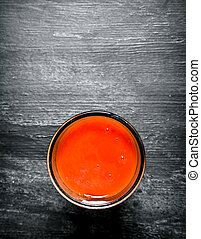 Fresh tomato juice in the glass.
