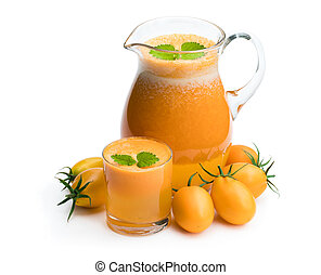 Fresh tomato juice made from the golden-yellow tomatoes in jar isolated