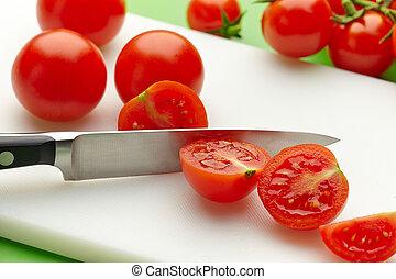 fresh tomato on cutting board