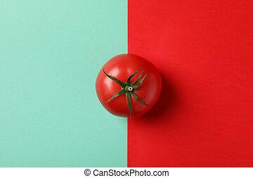 Fresh tomato on two tone background, top view