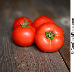 Fresh tomato on wooden background, closeup