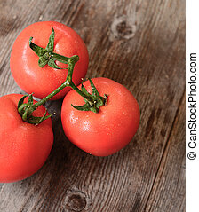 Fresh tomato on wooden background