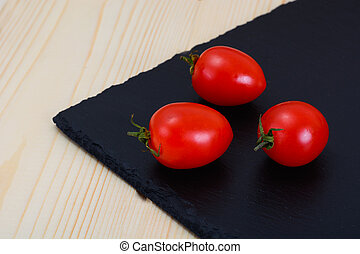 Fresh Tomato on Wooden Background.
