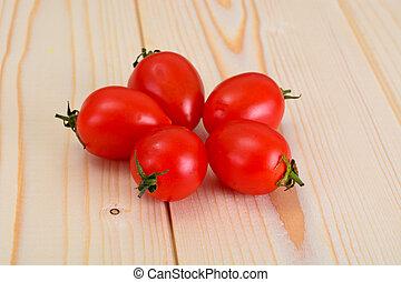 Fresh Tomato on Wooden Background.