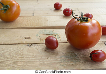 fresh tomato on wooden table