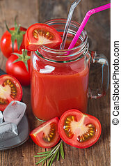 Fresh tomatoes and a glass of tomat