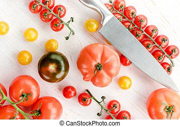 Fresh tomatoes and knife