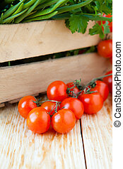 fresh tomatoes and onions in a wooden crate