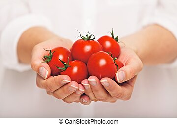 Fresh Tomatoes as an Antioxidant - Female with a handful of...