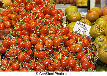 fresh tomatoes at a fruit market