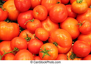 Fresh tomatoes at a market stall