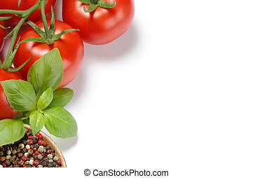 Fresh tomatoes, basil and grain pepper forming a frame with ...