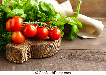 fresh tomatoes for salad on a wooden table