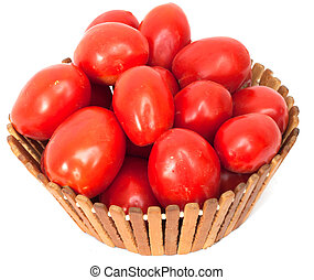 fresh tomatoes in a basket on a white background