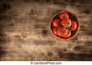 Fresh tomatoes in a wicker basket.